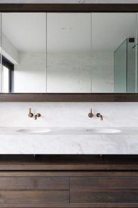 marble bathroom buck and simple architecture detail brass oak